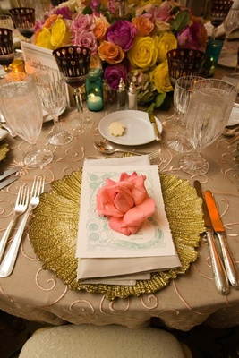 Gold textured charger plate with pink rose on top