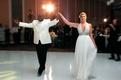 White jacket groom and sparkle halter dress bride