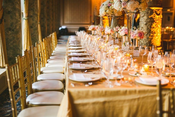 wedding reception decor gold linen gold chair tall centerpiece pink white rose hydrangea flowers