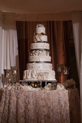 Six layer cake with ruffles, ribbons, and pearls