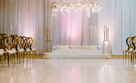 modern wedding ceremony gold chairs acrylic lucite arch white rose hydrangea orchid flowers