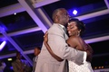 Bride in a spaghetti strap Pnina Tornai beaded dress dances with father in grey suit