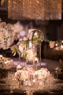 wedding reception centerpiece round table tall hurricane vase glass orb pink tulip rose white roses