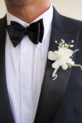 White gardenia groom boutonniere on tuxedo lapel