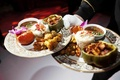 Gold-rimmed plates with traditional food from India