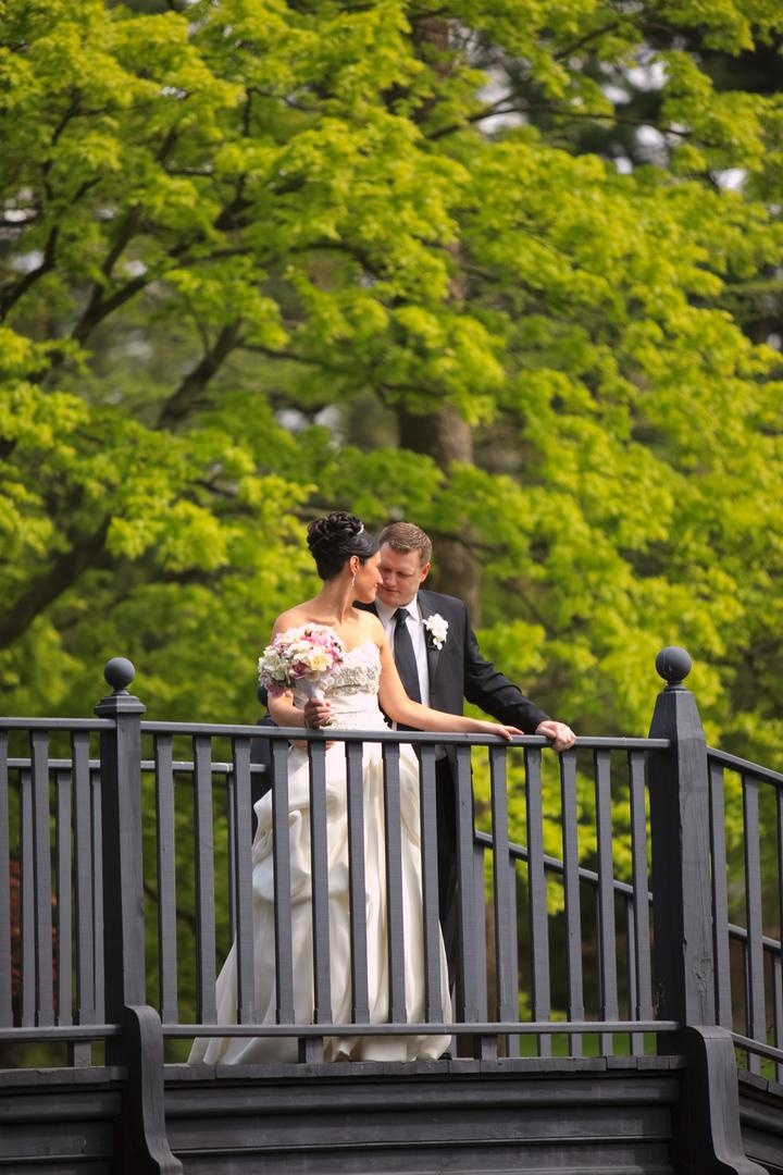 Bride in a strapless Monique Lhuillier gown and groom in a black tuxedo