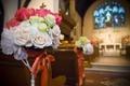 Church pew flower arrangements for wedding