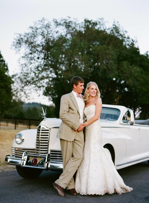 Bride and groom next to 1938 Packard limo