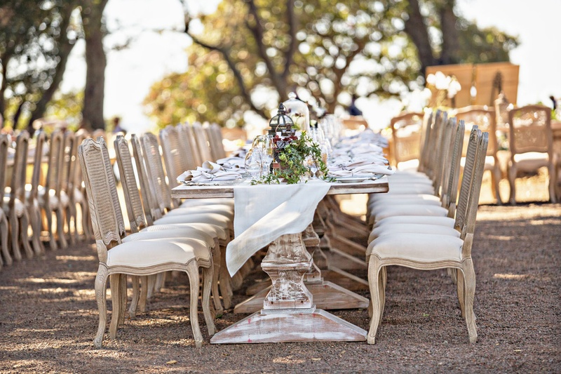 Wedding Reception Outside Long Wood Pedestal Tables With Chairs Upholstered Linen Runner