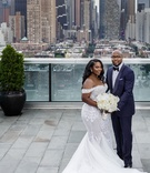 Bride in mermaid dress off the shoulder groom in suit and tuxedo bow tie skyscrapers