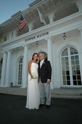 Bride and groom in front of Tupper Manor