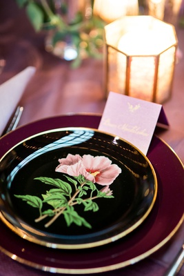 bold black and gold wedding china plates with pink flower design tent place card candlelight