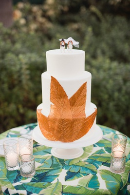 white wedding cake with copper leaf decoration, dog cake topper