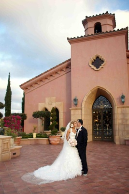 Couple kiss outside The Grand Del Mar