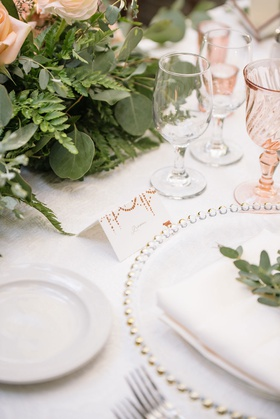 wedding reception tablescape beaded charger plate minted place card greenery fern rose pink glasses