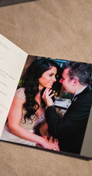 Wedding program with different sections and photos of the couple