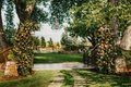 wedding reception ideas garden event party large gate decorated with flowers and greenery chandelier