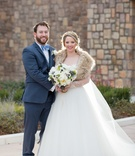 couple winter wedding attire embracing navy suit ball gown bouquet north carolina wedding headpiece