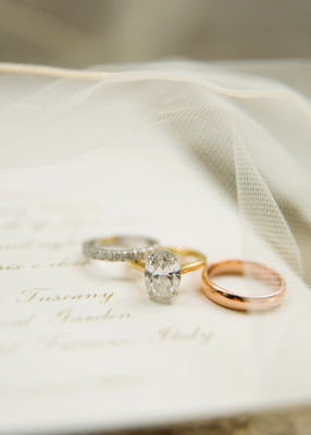white gold eternity band with oval diamond yellow gold engagement ring and rose gold men's band