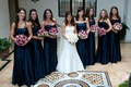 Bride with bridesmaids in navy blue strapless gowns