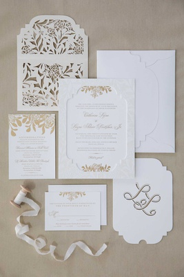 wedding invitation suite white gold monogram die cut laser cut envelope  ribbon