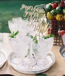 Antique cut crystal glassware on silver tray with mint mojito non alcoholic beverage for wedding