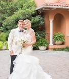 Bride in Hayley Paige mermaid gown with crystal bolero groom in white tuxedo jacket bow tie Dallas
