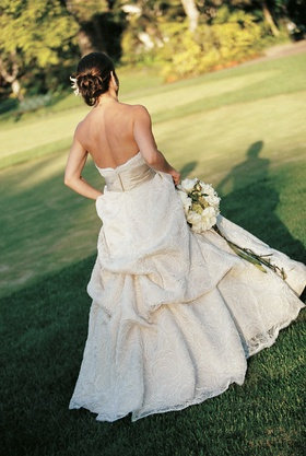 Bride in champagne wedding dress on golf course