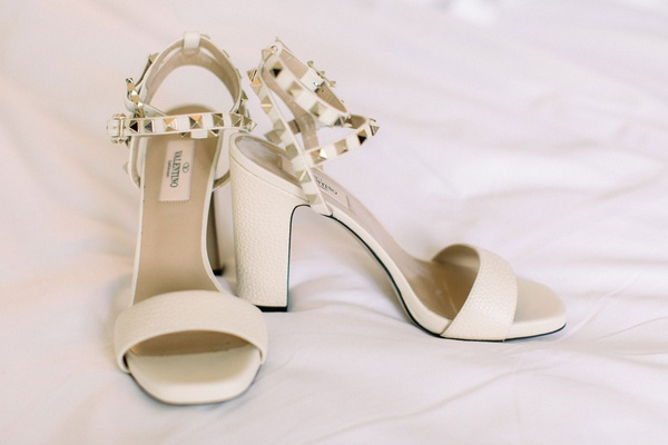 valentino wedding shoes white ivory sandal with thick heel and gold pyramid studs on straps