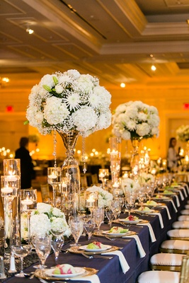 Blue reception table with white hydrangea and crystal decoration