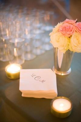 Wedding monogram initials on white paper napkins