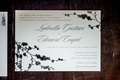 black and white wedding invitation with black flowers