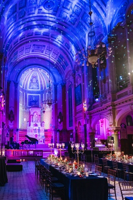 wedding reception venue high arch ceiling former chapel cathedral long tables candelabra lights