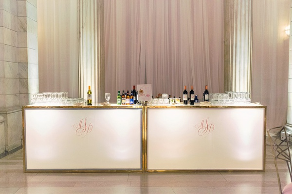 wedding reception bar station gold border pink monogram drapes marble column