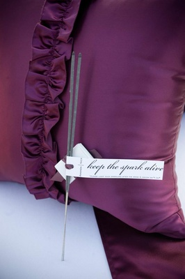 Sparklers on purple pillow with custom tag