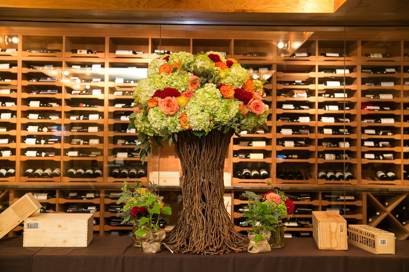 Wine cellar room with branch tree centerpiece and wood boxes