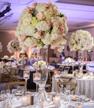 round table blue and gold place setting white blush hydrangea rose tall centerpiece floating candles