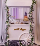 Wedding reception dessert cart idea macaron tower desserts on trays garland flowers