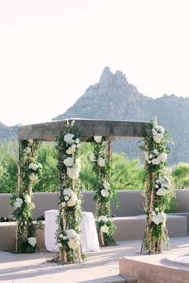 Wood chuppah at desert wedding with hydrangea