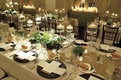 Long tables with candlelight and desert plants