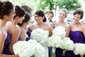 White bridal party bouquets and purple dresses