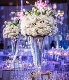 Wedding reception centerpiece, light pink rose, white hydrangea, white tulip flowers purple lights