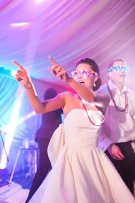 Wedding reception dance floor bright lights party blinking light up glasses and necklaces