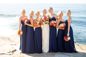 bride bridesmaids navy colorful bouquets seaside cliff side buns beachy wedding california