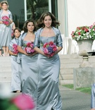 Bridesmaids holding colorful bouquets and wearing shawls