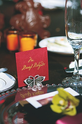 Red and gold escort card with silver butterfly place card holder