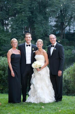 Bride with groom, mom, and step dad at New York wedding