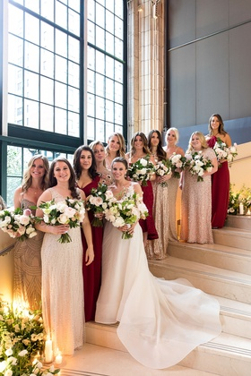 Bride with bridesmaids in mismatched bridesmaid dresses assorted styles, colors, and materials