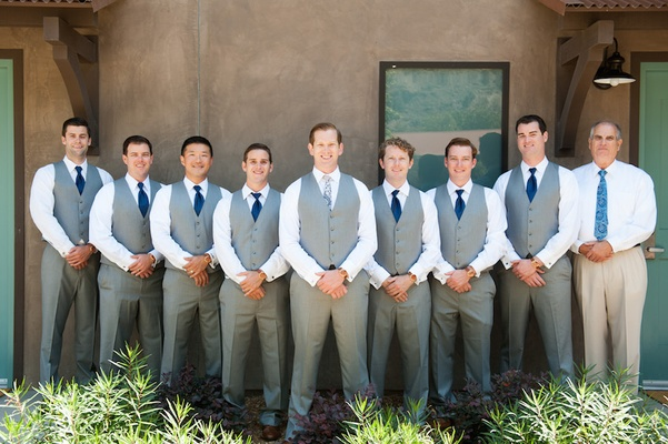 Groom and groomsen in grey vests, pants, navy blue ties at The Ranch at Laguna Beach