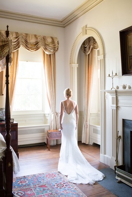 Wedding dress with lace material straps v back low back in bridal suite